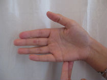 Image of hands doing EFT tapping.